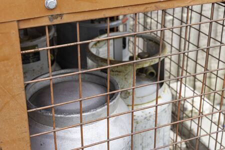 Propane Gas Cylinders in locked cage for safekeeping