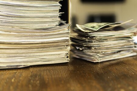 Stack of old photo prints and Memories to be digitized a