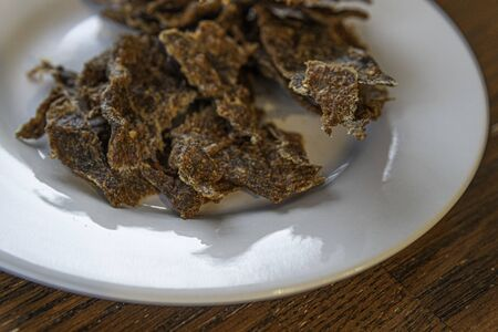 Dried meat called Kilishi in Nigeria. The meat is sliced into thin sheets and dried, salted and spiced.