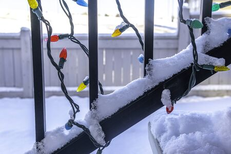 Christmas lights covered in snow oh house railings 版權商用圖片
