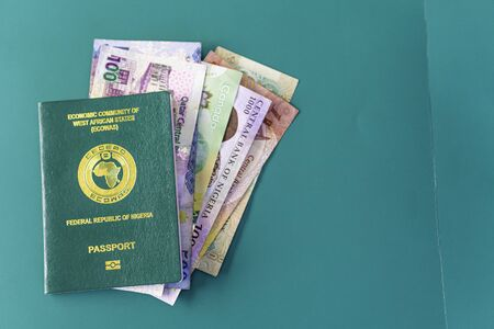 Nigerian Passport with various currencies