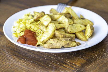 Fried Potatoes with Eggs and Ketchup - Meal time