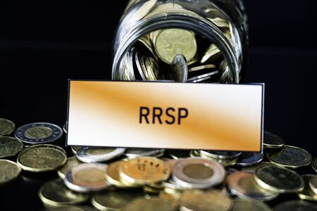 Bottle of coins with RRSP sign - Retirement and savings concept Фото со стока