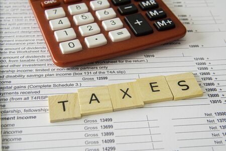 New Updated Tax Canadian Tax Forms with letter tiles spelling - Taxes 版權商用圖片