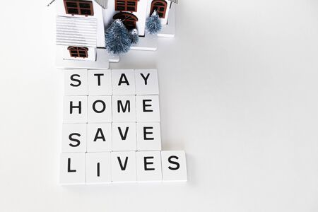Stay at home for Self isolation during Covid 19 Pandemic with Letter Tiles - Health concept