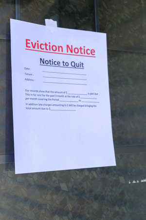 Eviction Notice served to tenant hanging on door
