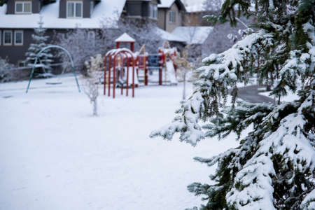 Childrens playground in public park covered in snow