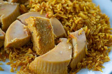 Nigerian Moi Moi beancake with Jollof Rice