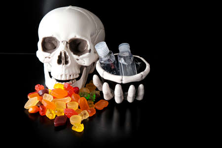 Skeleton Skull with Candy to eat during Halloween