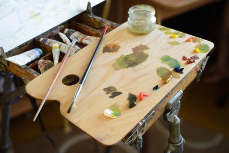 window light: Set For The Artist. Sketchbook, Oil Paints, Brush, Palette, canvas. Window Light.