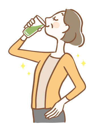 Middle-aged woman drinking green juice