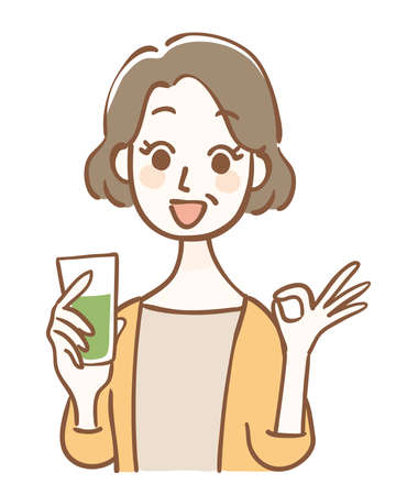 Middle-aged woman holding green juice and OK pose