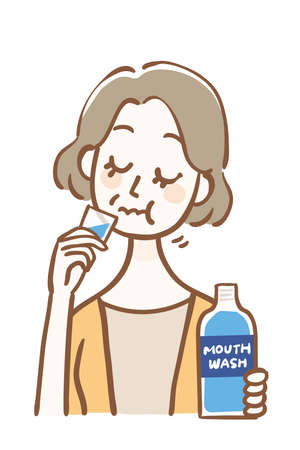 Middle-aged woman doing bad breath care with mouthwash