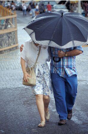 Couple walking in the rain photo