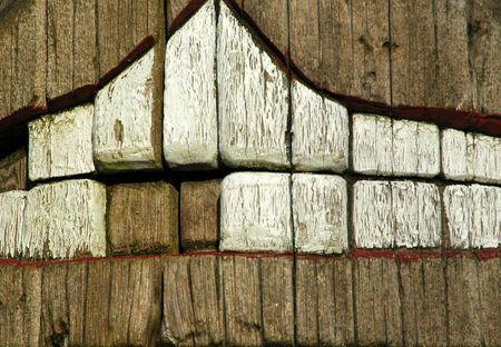 Missing Teeth in a wood carving.