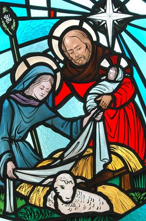 Nativity on a stained glass window.