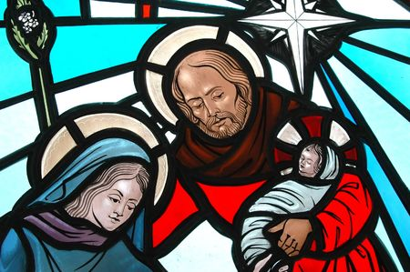 Nativity on a stained glass church window.