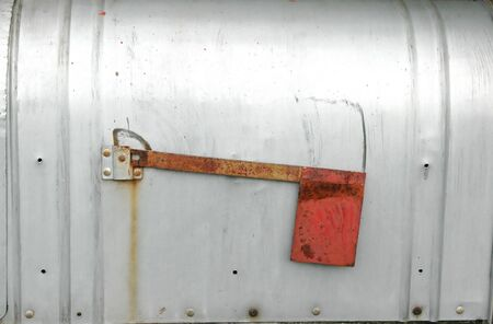 Metal mailbox with a red flag