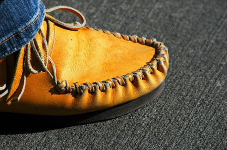 moccasins: Native american wearing moccasins, and jeans. Stock Photo