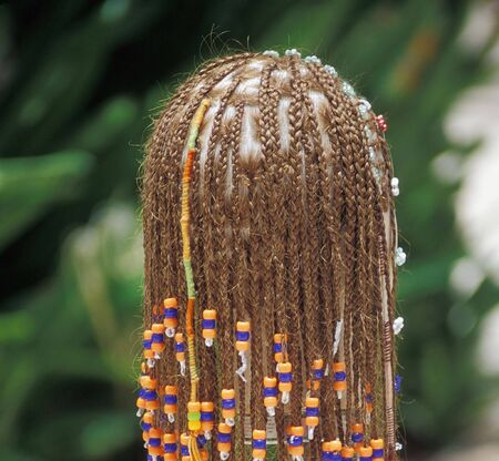 Female wearing hair braids and extensions.