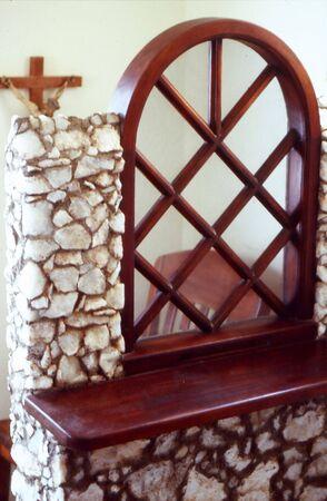 Open confessional box in a church.