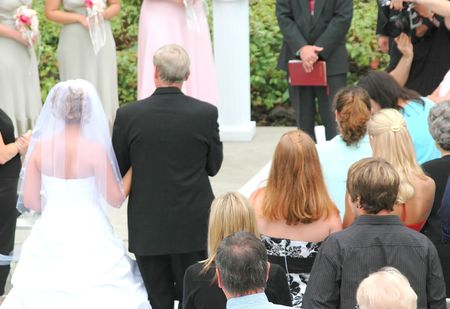 escorting: Father escorting his daughter down the altar. Stock Photo