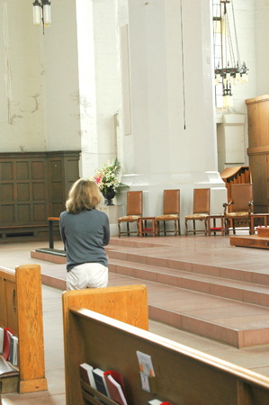 Woman in a place of worship.