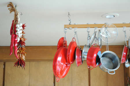 Hanging pots and pans in a kitchen.