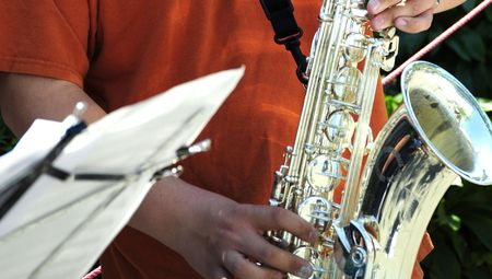 Saxophone player performing in concert.