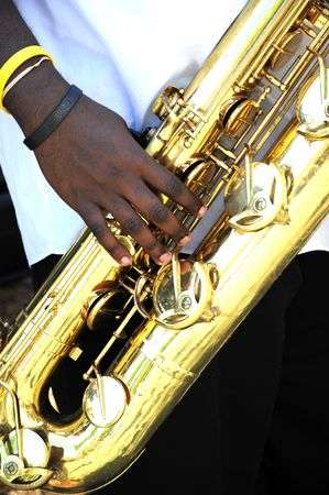 african sax: Saxophone player performing in concert.