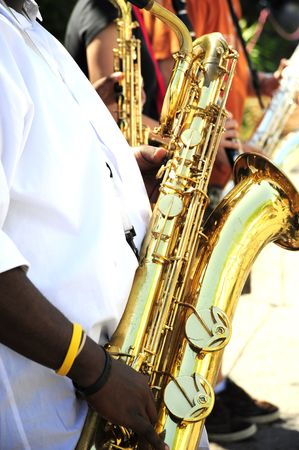 african sax: Saxophone ensemble performing in concert. Stock Photo