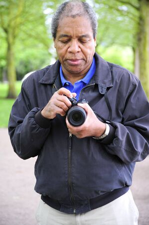 African american male photographer on assignment.