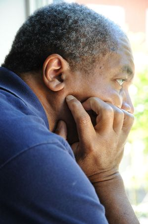 feeling sad: African american man feeling sad and depressed. Stock Photo