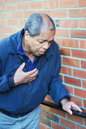 pains: African american male having chest pains.