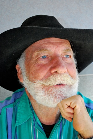 Portrait of a cowboy with a long white beard. photo