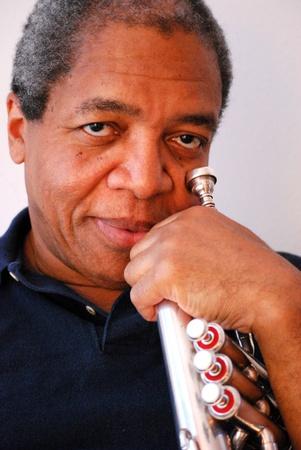 flugelhorn: African american with his flugelhorn.