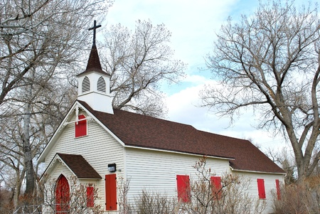 Old wooden church in a country setting. photo