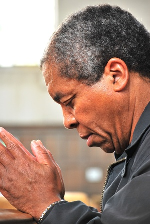 African american male praying in church. photo