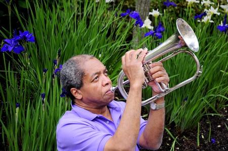 flugelhorn: African american jazz musician playing his flugelhorn.