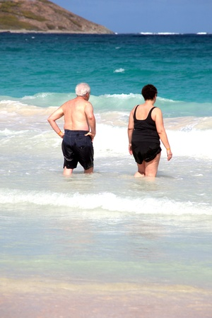 Mature couple on a cruise vacation at the beach. photo