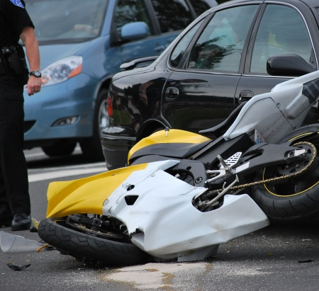 Motorbike accident at an intersection. photo