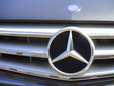 benz: 7262011: Mercedes Benz hood and grill logo. Editorial