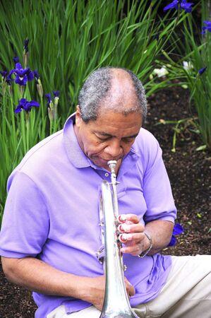 flugelhorn: African american jazz musician blowing his horn.