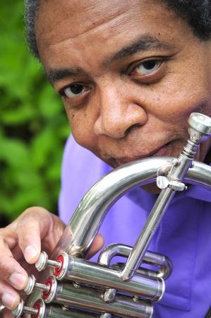 flugelhorn: African american jazz musician with his flugelhorn.
