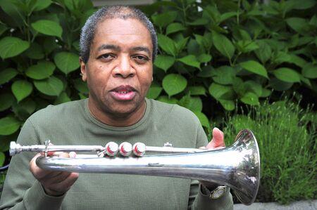 flugelhorn: African american man with his flugelhorn. Stock Photo