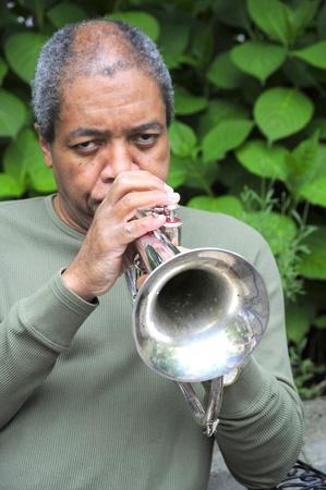 flugelhorn: African american man blowing his flugelhorn. Stock Photo