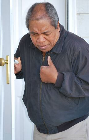 pains: African american man having chest pains.