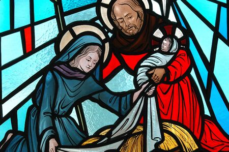 stained glass windows: Stained glass window of the nativity. Stock Photo