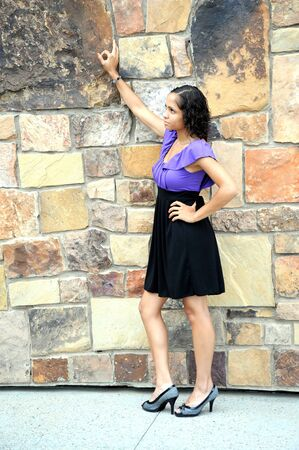 African american female beauty posing outside.