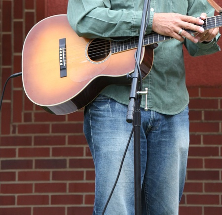 Guitarist performing in concert outdoors